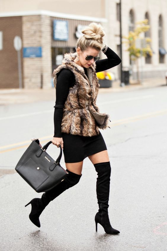 fux fur vest, belted and layered over long-sleeve sweater and over-the-knee boots