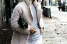 16 white jeans, a grey sweater and a blush coat