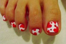 17 red and white nails with a heart print