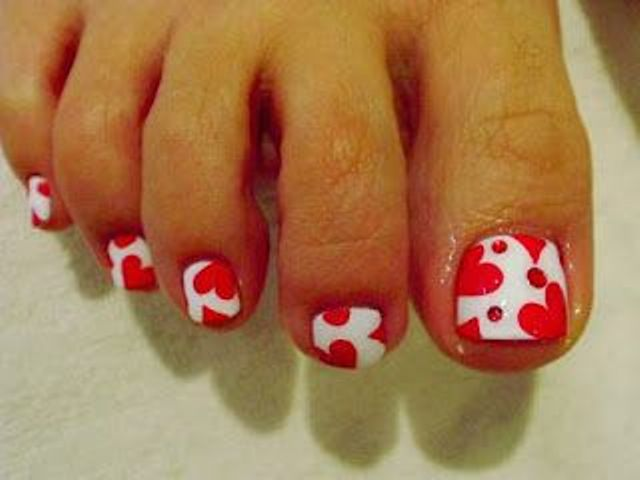 red and white nails with a heart print