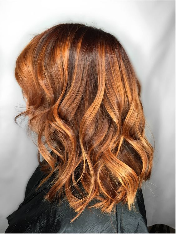red hair with copper balayage for a more natural look