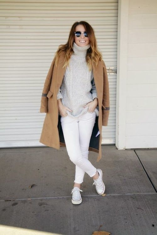 white jeans, a white cable knit sweater, white Converse and a brown coat