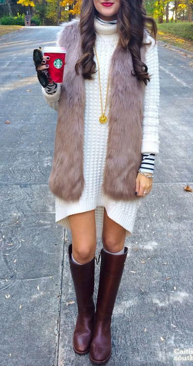 white sweater dress, a faux fur vest, burgundy knee boots and leg warmers