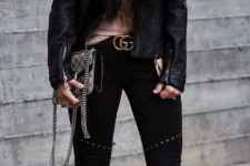 19 black pumps, black denim, a brown top and a black leather jacket with fur