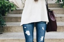 19 knee suede boots, ripped jeans and a white sweater