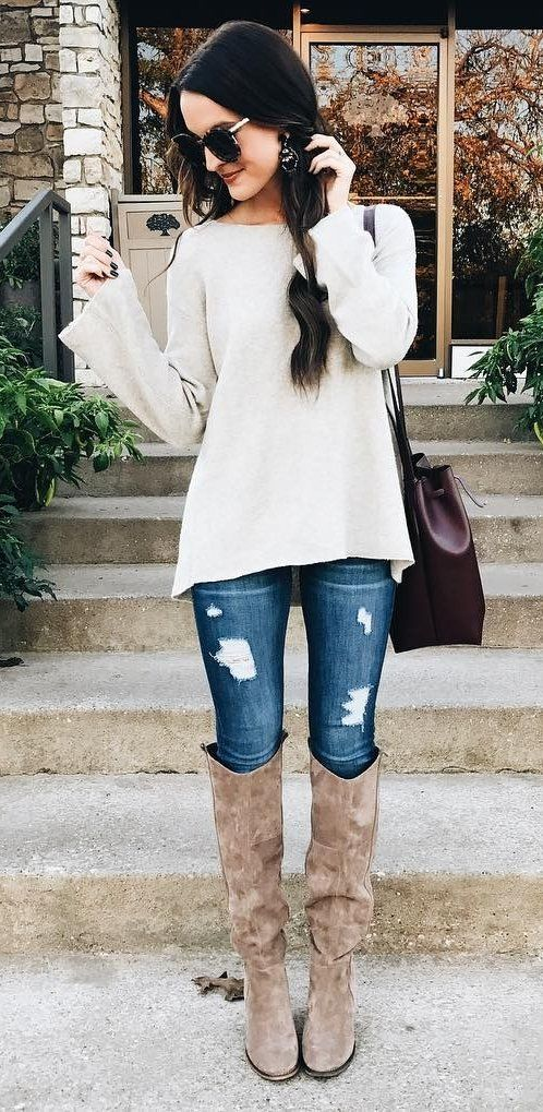 knee suede boots, ripped jeans and a white sweater