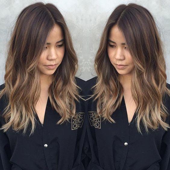 dark brown medium length hair with light highlights