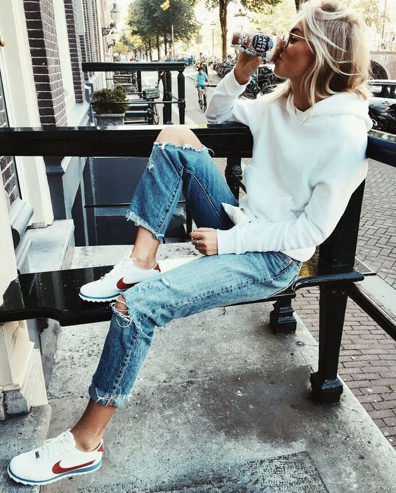 plain white hoodie, ripped jeans and sneakers