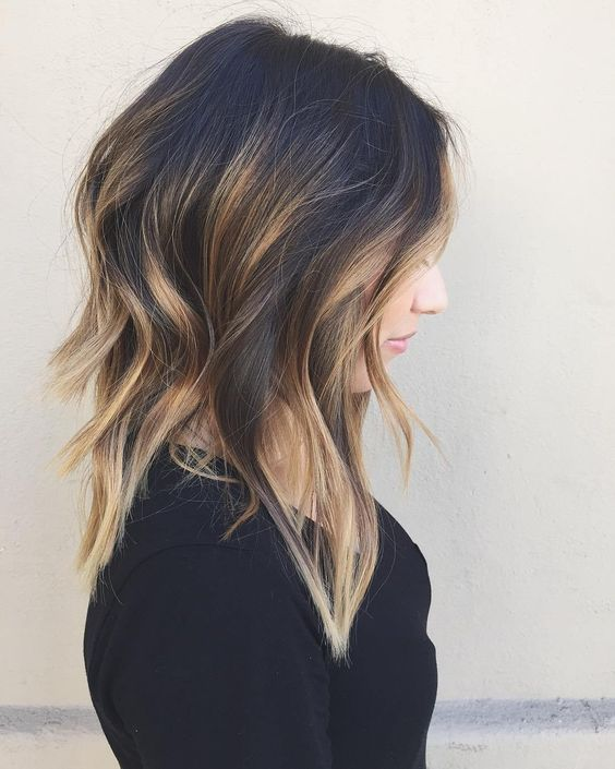 black layered hair with blonde balayage