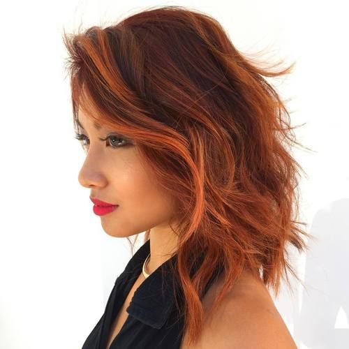 short red hair with copper locks for a bold statement