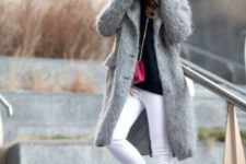 21 white jeans, grey trainers, a navy sweater and a fuzzy grey coat