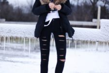 22 ripped black denim, flat boots, a printed tee and a parka