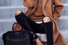 23 ripped black jeans, an ocher coat and sweater, leopard shoes