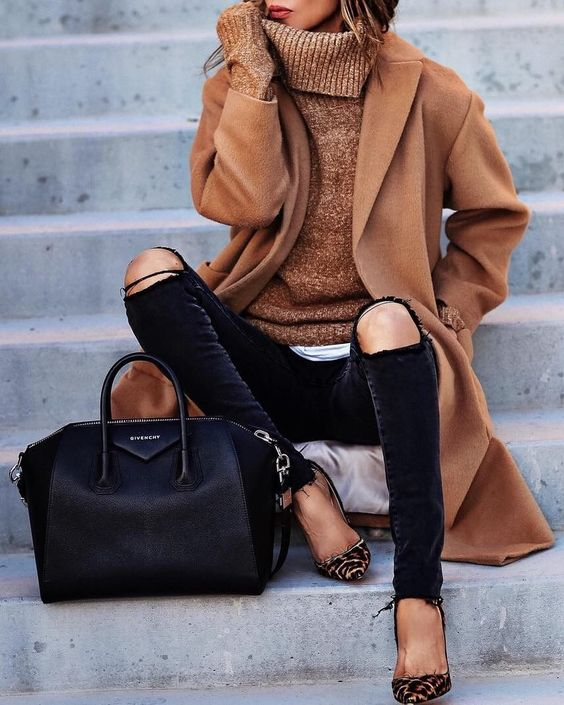 ripped black jeans, an ocher coat and sweater, leopard shoes