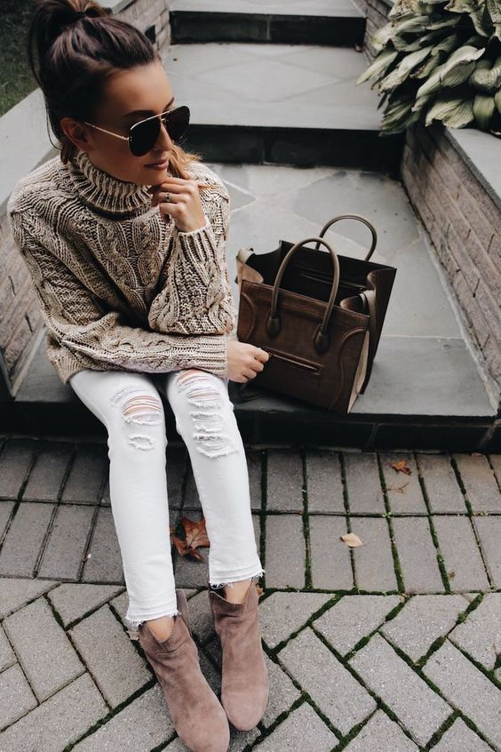 white ripped jeans, browwn booties and a brown turtleneck sweater
