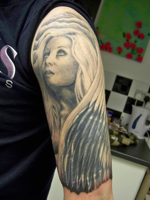 Picture of angel tattoo idea for Angel half sleeve tattoo