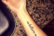 Arrow with word believe tattoo