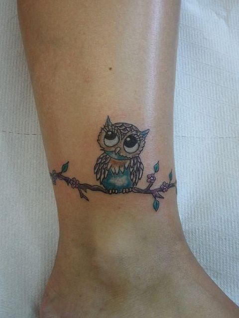 Awesome owl tattoo design on the ankle