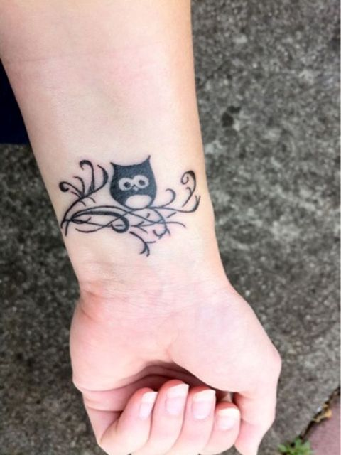 Beautiful owl on the left wrist