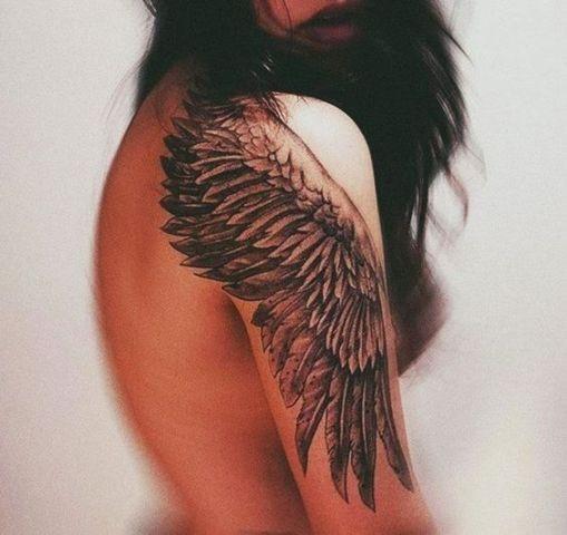 Big black wing tattoo