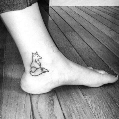 Black-contour fox tattoo on the ankle