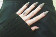 Black-contour moon tattoo on the finger
