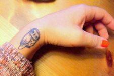 Black-contour tattoo on the wrist