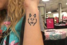 Black-contour wolf tattoo