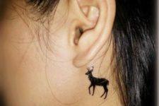 Black deer tattoo idea behind the ear