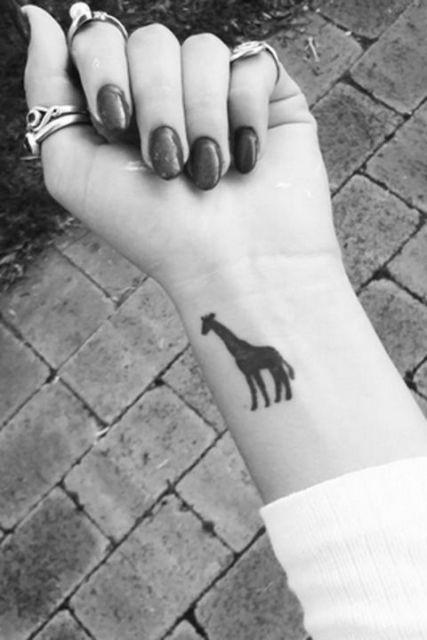 Black giraffe on the wrist