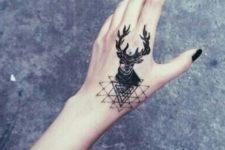 Black tattoo on the left hand