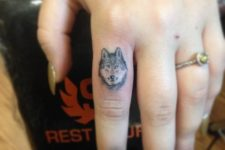 Blue color tattoo on the finger