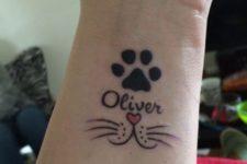 Cat tattoo on the wrist
