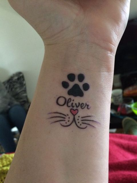 Cat tattoo on the wrist