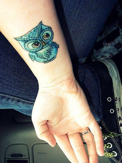 Colored owl on the wrist