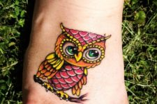 Colorful owl on the foot