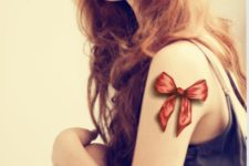 Cool 3D red bow tattoo