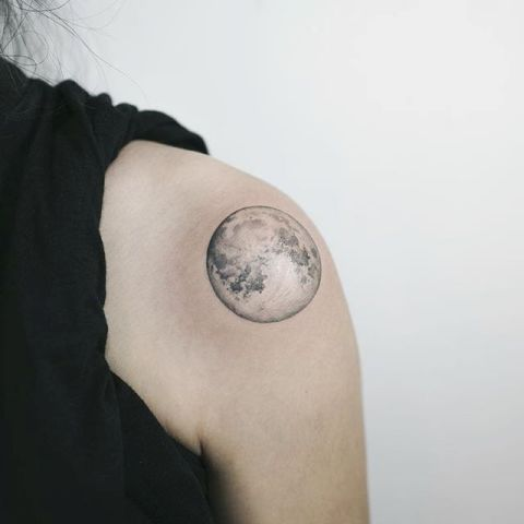 Cool moon tattoo on the shoulder
