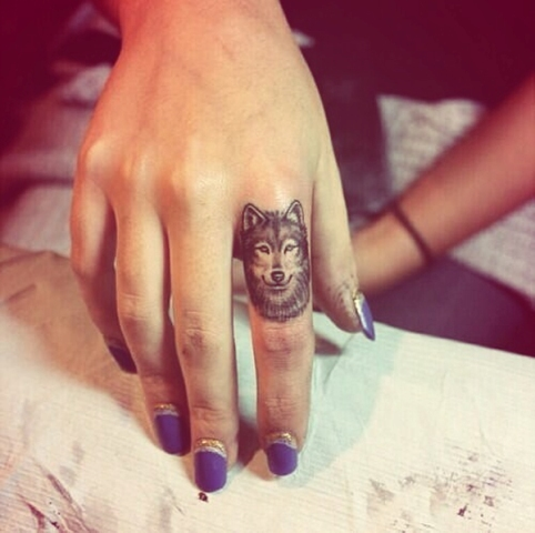 Cool wolf tattoo on the finger