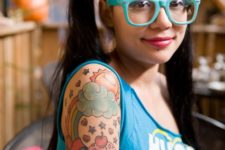 Cupcake, sun and rainbow tattoo