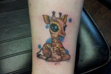 Cute baby giraffe tattoo