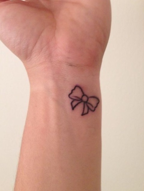Cute bow tattoo on the wrist