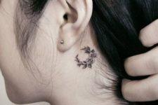 behind an ear tattoo