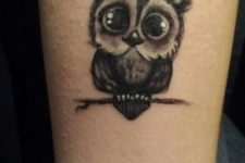 Cute owl tattoo idea on the arm