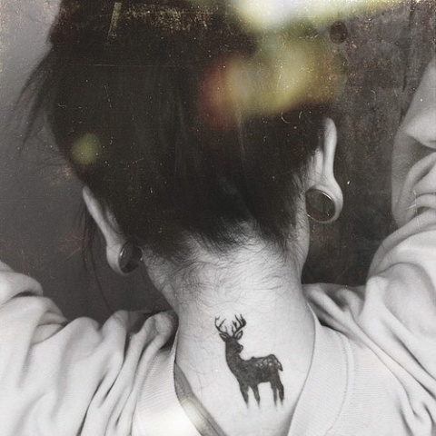 deer women tattoo