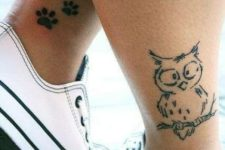 Funny owl tattoo on the leg