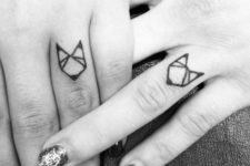 Geometric tattoo on the fingers