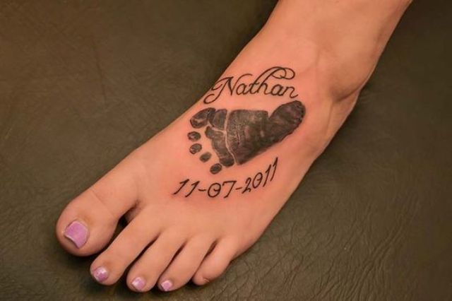 Newborn baby footprint with name and date tattoo