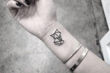 Origami tattoo on the wrist