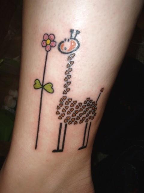 Original giraffe with flower tattoo